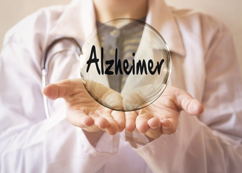 woman doctor holding a transparent bubble with alzheimer text, alzheimer concept