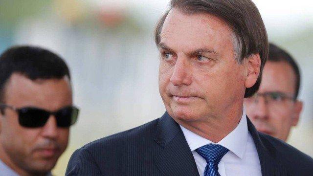 x86128907_brazils-president-jair-bolsonaro-looks-on-as-he-leaves-the-alvorada-palace-in-brasilia.pagespeed.ic.mvpgrhv4up